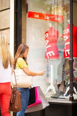 scanning qr code in shop window