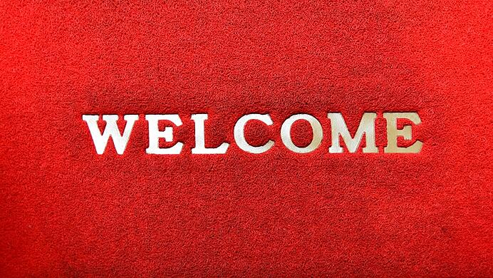 put out welcome mat for retail store