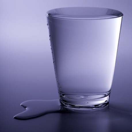 overflowing cup of water