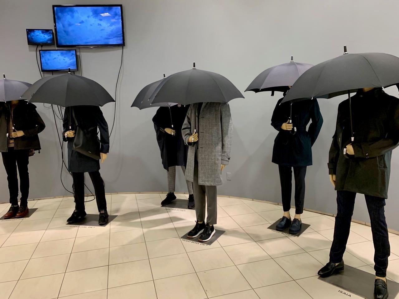 Saks umbrella raincoat display