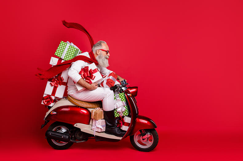 Man Christmas shopping like a hero